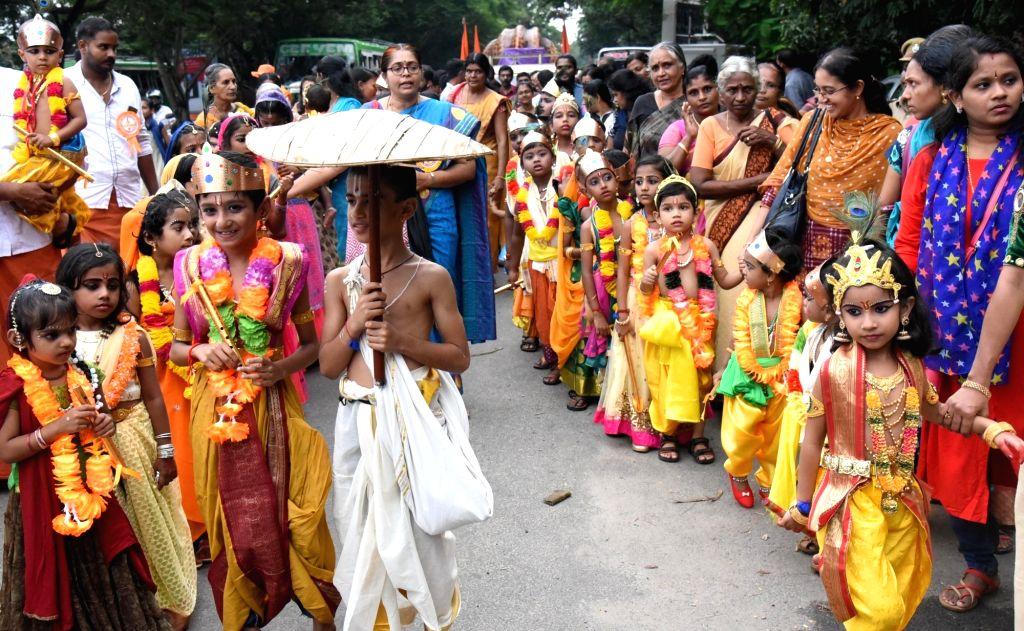 Children dressed up as Lord Krishna and Radha participate in 'Shobha Yatra' during Janmashtami celebrations in Kochi, Kerala on Aug 24, 2019.