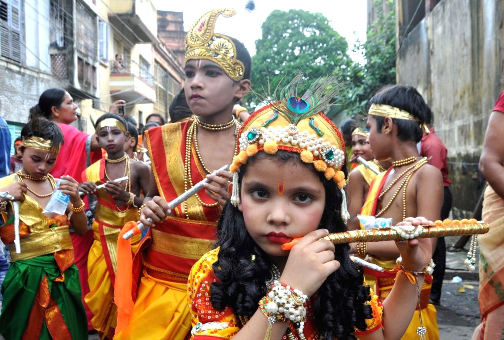 Children dressed up as Lord Krishna participate in a rally on the eve of Janmashtami, in Kolkata on Sept 2, 2018.