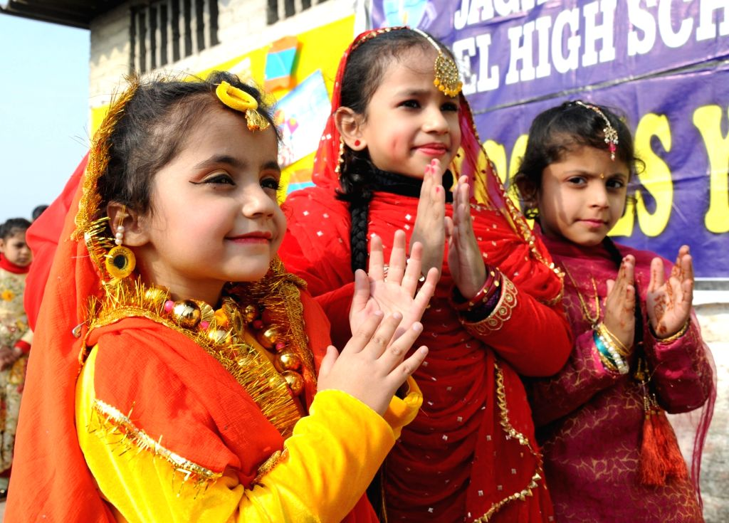 Children dressed up in traditional attires participate in Lohri celebrations at their school on the eve of the festival in Amritsar, on Jan 12, 2019.