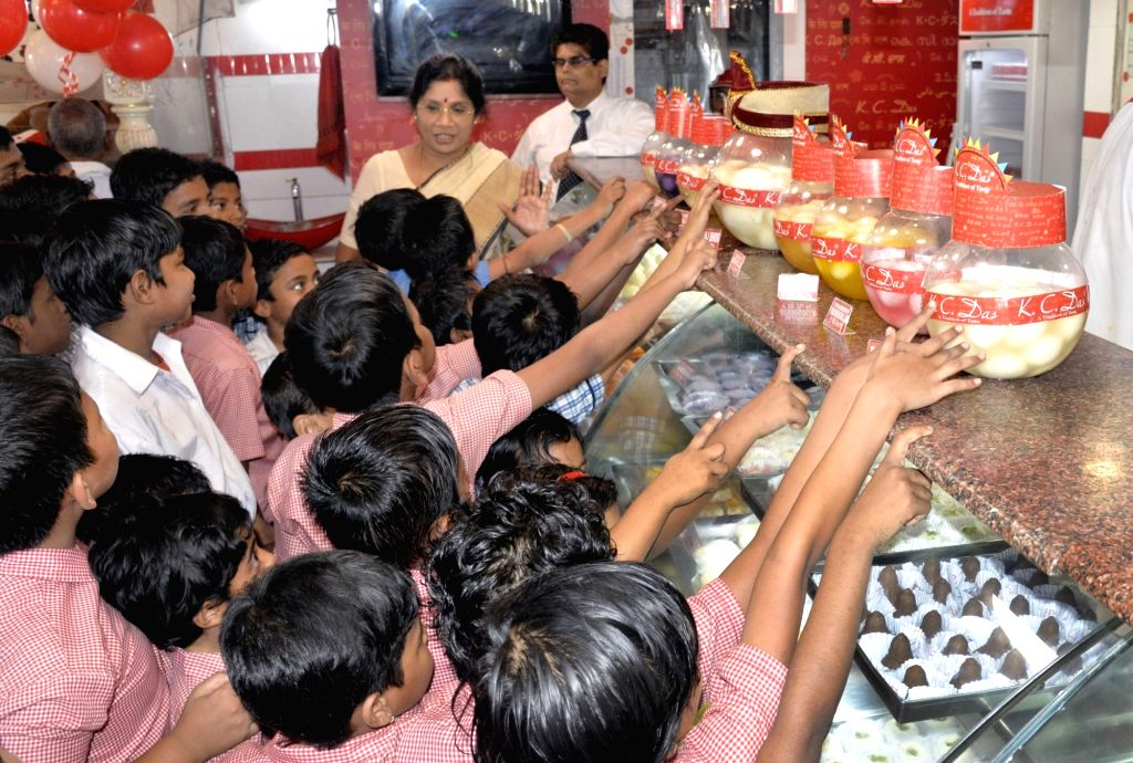 Children during 'Rosogulla Day' being observed across West Bengal on the occasion of Children's Day, in Kolkata on Nov 14, 2019. West Bengal government has decided to observe 'Rosogolla Day' ...