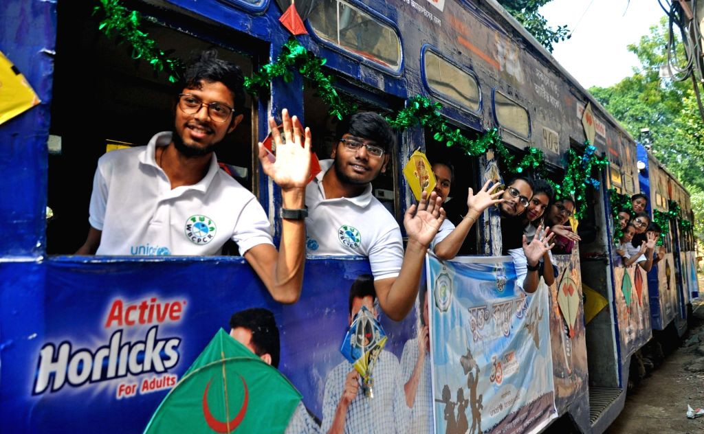 Children enjoy a tram ride organised for them on the occasion of the birth anniversary of the the country's first Prime Minister Pandit Jawaharlal Nehru, which is also celebrated as ... - Pandit Jawaharlal Nehru
