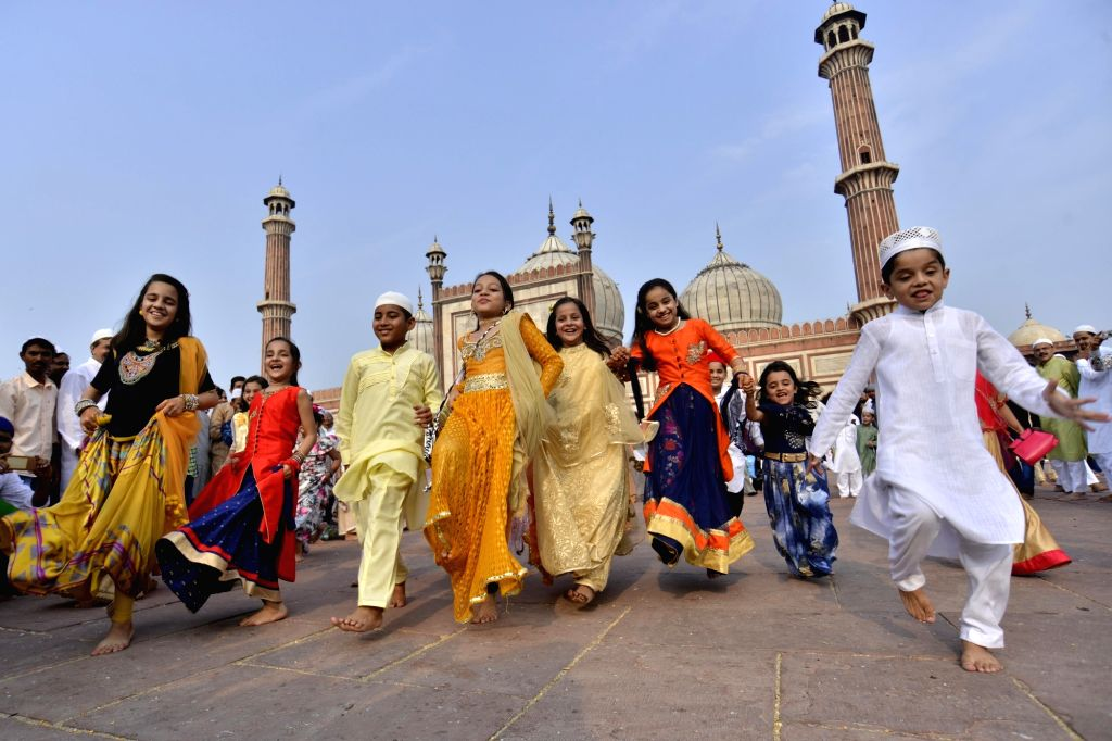 Children enjoy after prayers on the occasion of Eid-ul-Fitr at Jama Masjid in New Delhi on June 26, 2017.