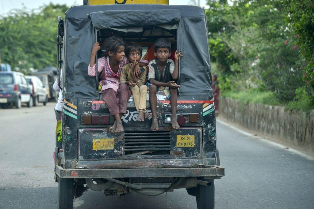 Children enjoy an auto-rickshaw ride on an overcast day in Ajmer, Rajasthan on Aug 9, 2019.