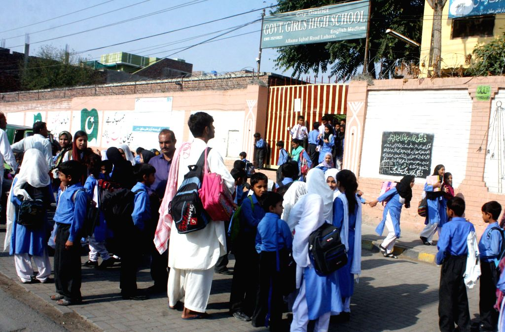 Children evacuate from their school after a severe earthquake in eastern Pakistan's Lahore on Oct. 26, 2015. At least 125 people were killed and over 1,000 others ...