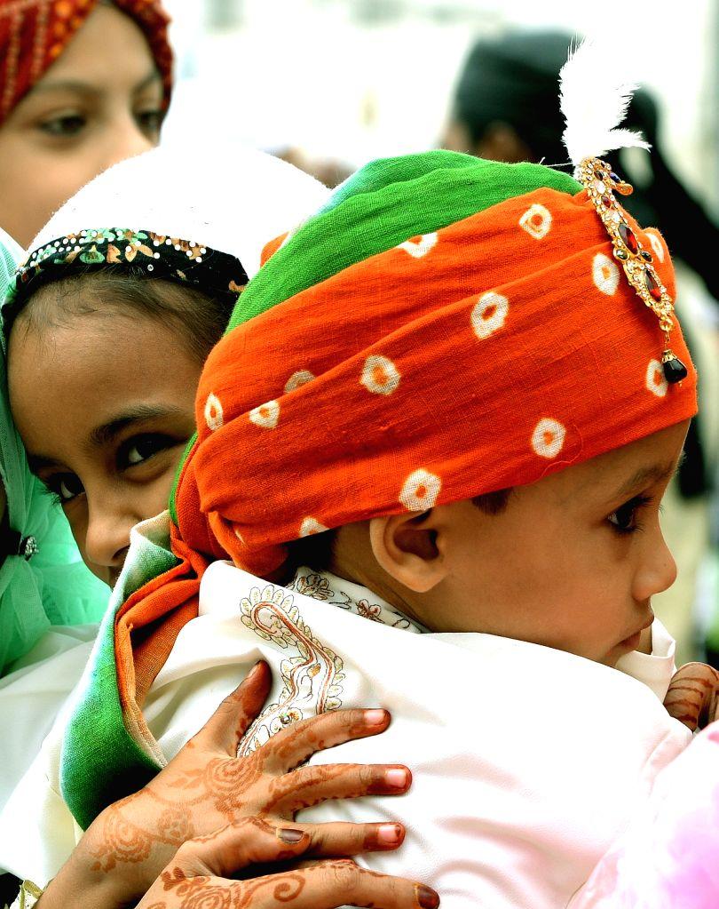 Children greet after prayers on the occasion of Eid-ul-Fitr at Idga Maidan in Bengaluru on June 26, 2017.