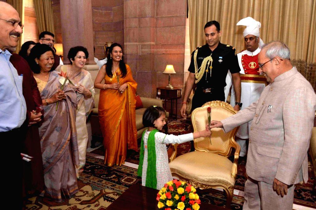 Children greet President Pranab Mukherjee on Diwali in at Rashtrapati Bhawan in New Delhi on Oct 30, 2016. - Pranab Mukherjee