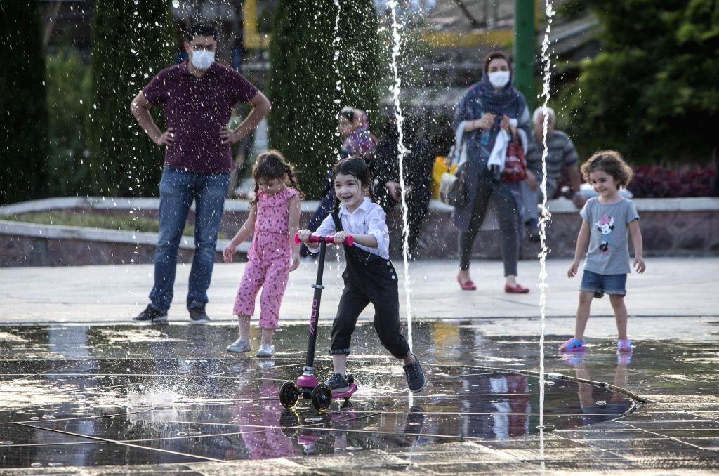 Children have fun in a park during the Eid al-Adha holiday in Tehran, Iran, on July 31, 2020.