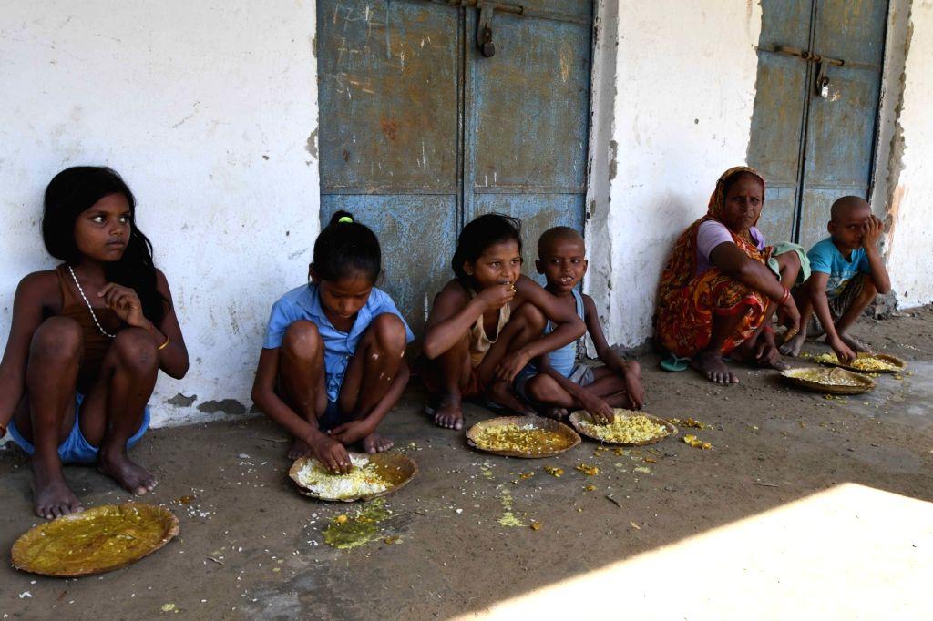 Children have their meals in flood hit Katihar in Bihar on Aug 19, 2017.