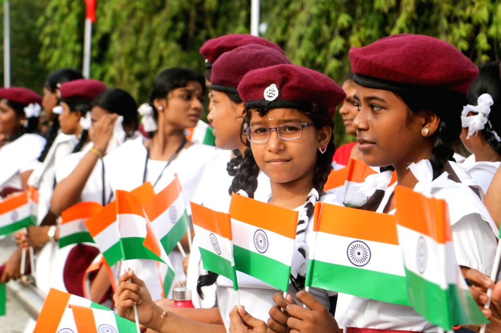 Children hold the national flag on the 71st Independence Day celebration in Chennai on Aug 15, 2017.
