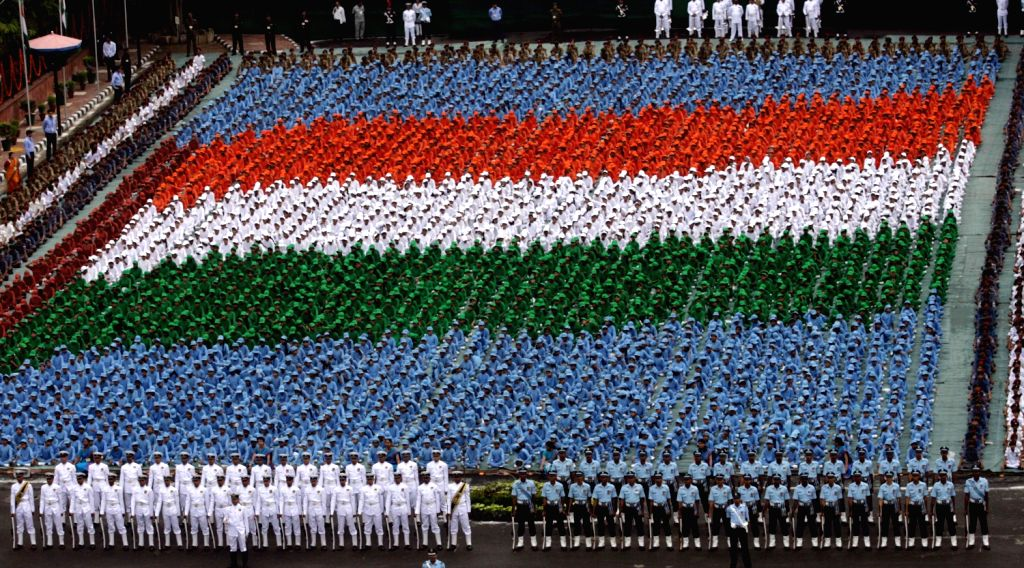 Children in tricolor formation at the Historic Red Fort, on the occasion of 67th Independence Day, in Delhi on August 15, 2013. (Photo::: IANS)