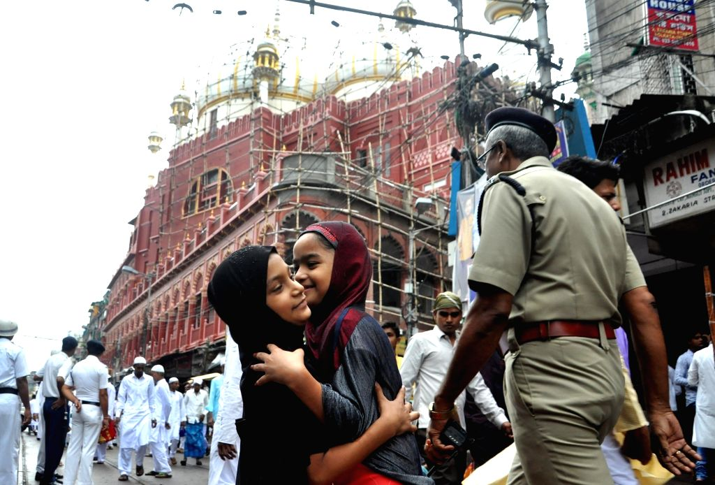 Children offer greetings after the prayer on the occasion of Eid-ul-Fitr at Nakhoda Masjid in Kolkata on June 26, 2017.