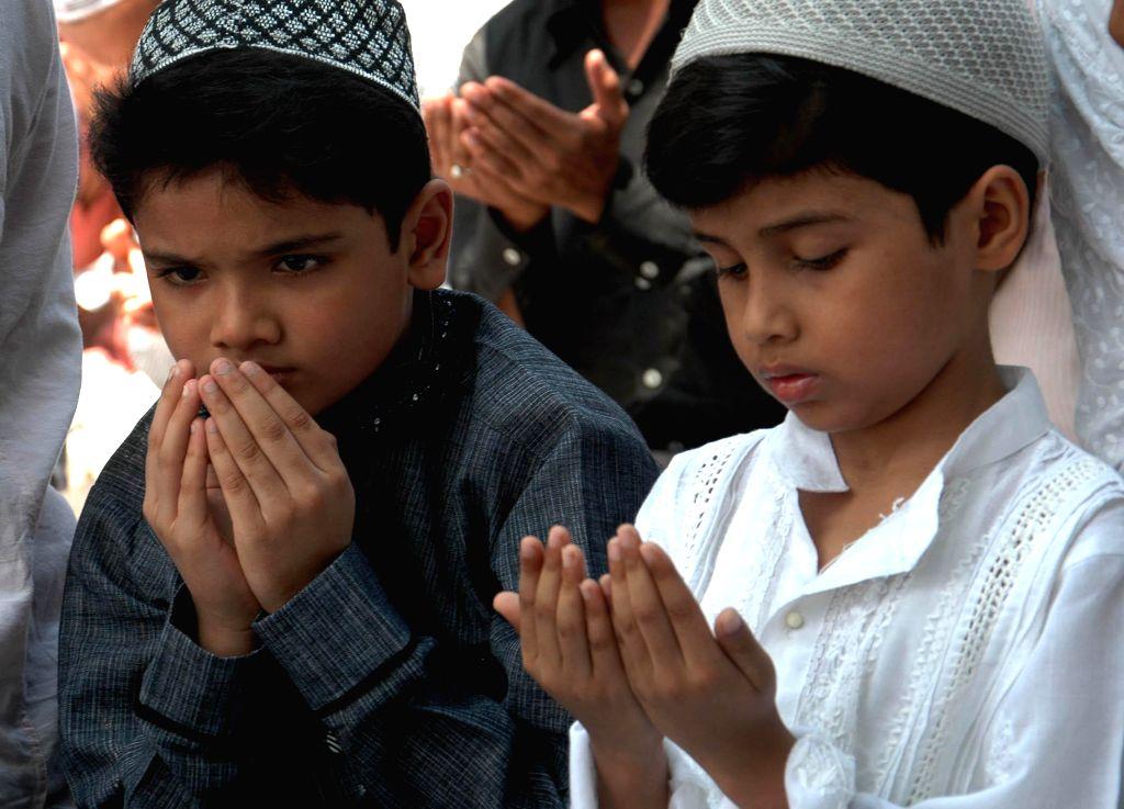 Children offer prayers on Juma-tul-Vida, the last Friday of the holy month of Ramadan in at Tipu Sultan Masjid in Kolkata on July 25, 2014.