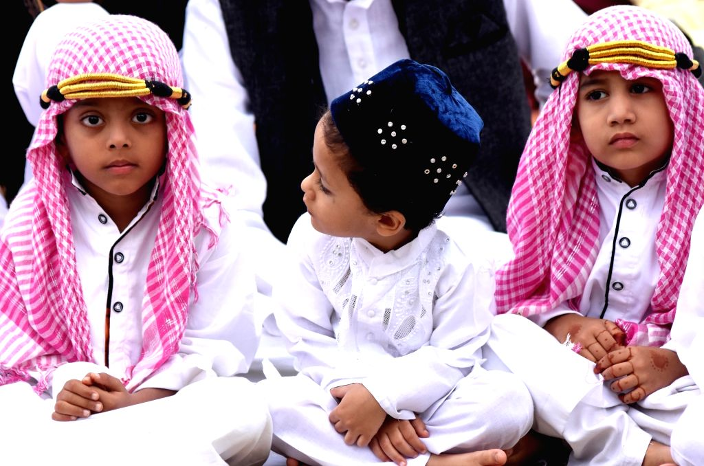 Children offer prayers on the occasion of Eid-ul-Fitr at Idga Maidan in Bengaluru on June 26, 2017.