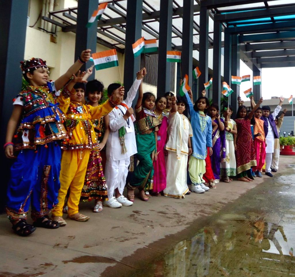 Children participate during a programme on the eve of Independence Day in Mumbai, on Aug 14, 2015.