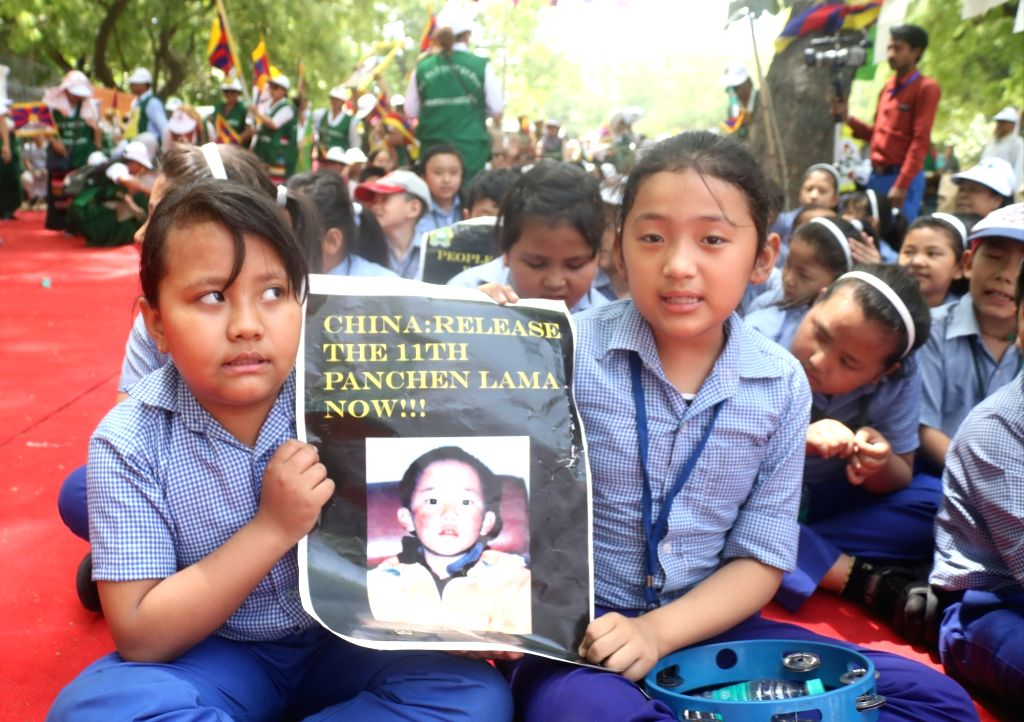 Children participate in a demonstration to commemorate the 30th birthday of the 11th Panchen Lama, with a demand of his immediate release from the custody of the Chinese government, in New ...