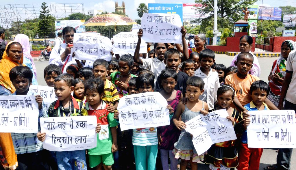 Children participate in a rally organised on International Literacy Day in Patna on Sept 8, 2014.