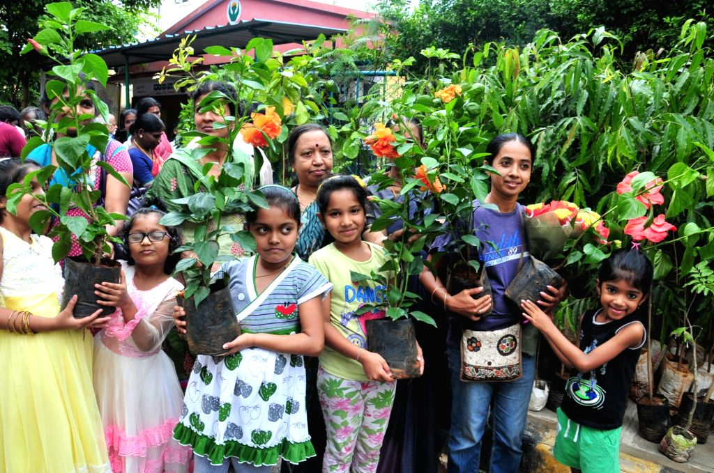 Children participate in an awareness rally on World Environment Day in Bengaluru, on June 5, 2016.