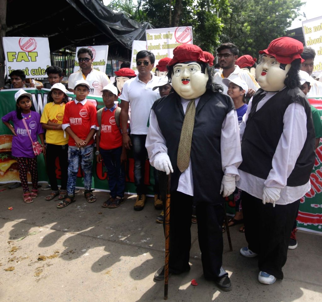 Children participate in an awareness rally on World Obesity Day in Kolkata, on Oct 11, 2017.