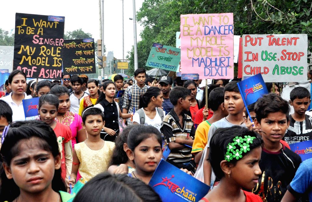 Children participate in awareness rally against child abuse and child labour, in Kolkata, on July 29, 2018.