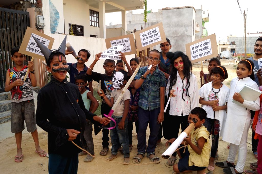"""Children participate in """"Give up your addiction"""" march to spread awareness about the ill effects of the consumption of tobacco on the occasion of World No Tobacco Day, in Varanasi ..."""