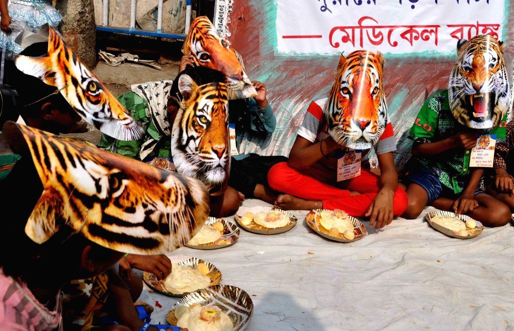 "Children participate in ""Save Tiger"" campaign during Bhai Duj in Kolkata, on Nov 13, 2015."