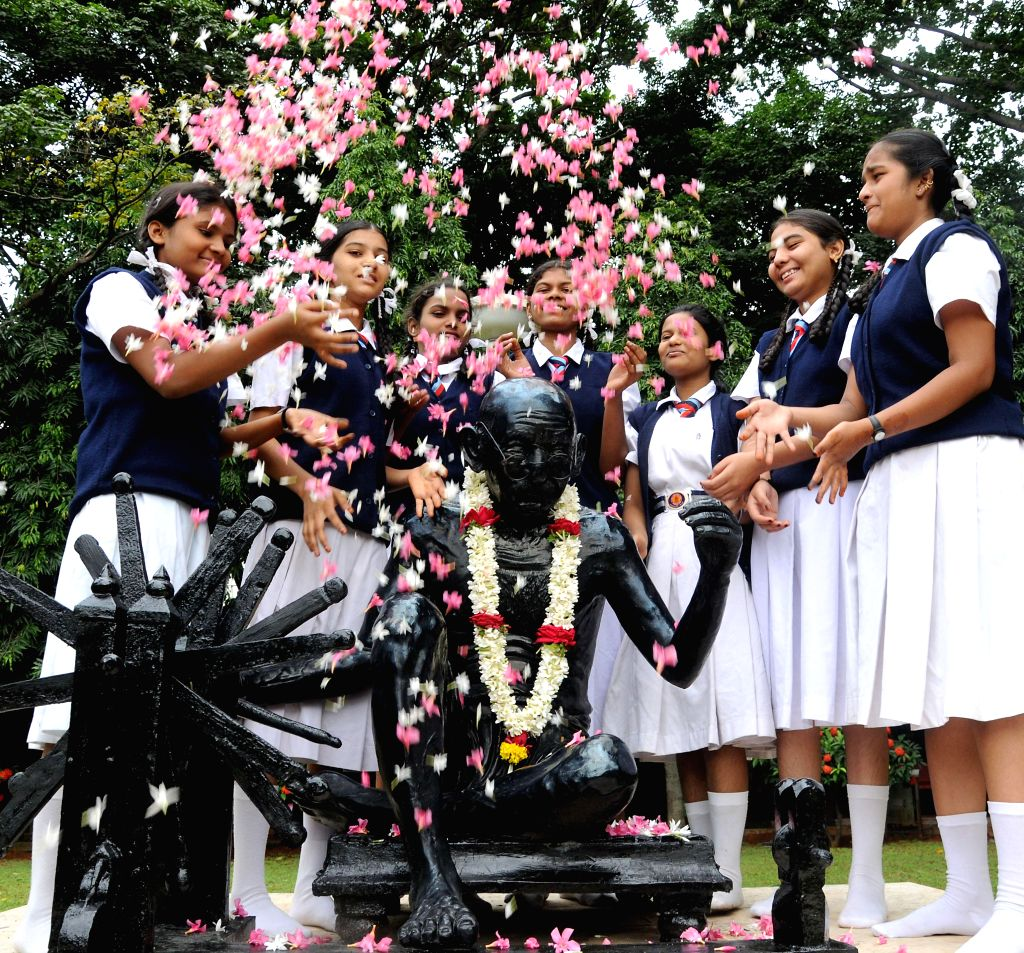 Children pay tribute to Mahatma Gandhi on occasion of anniversary of ``Quit India Movement`` in Bangalore on Aug. 9, 2014.