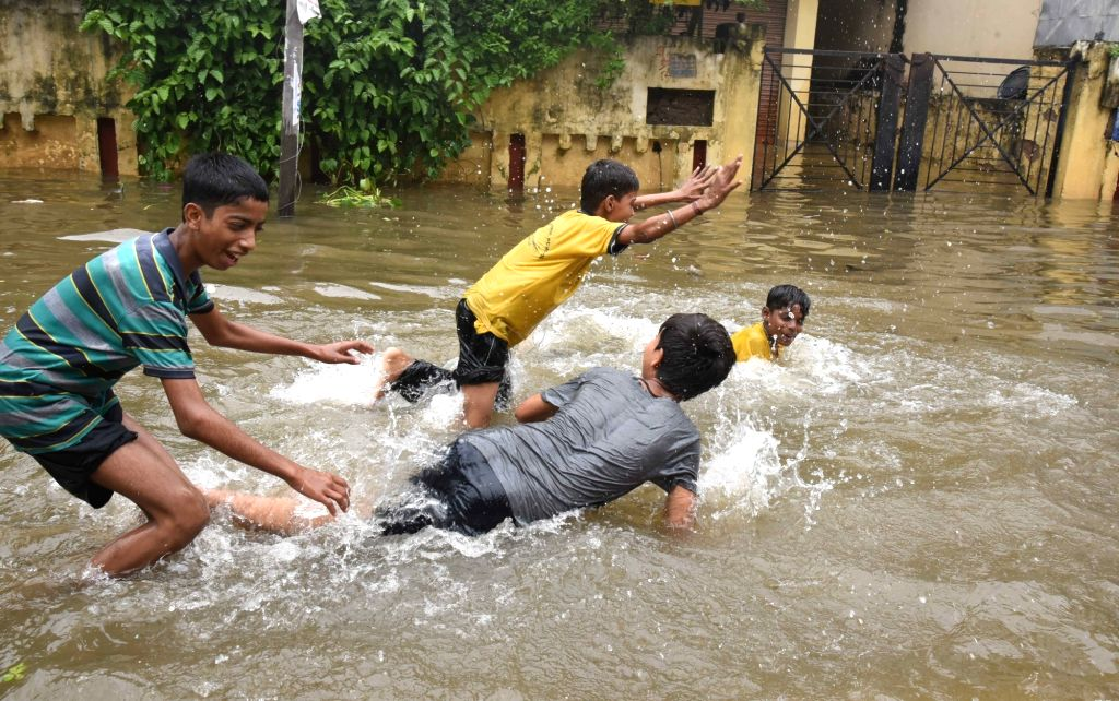 Children play on an inundated street of the flood affected Patna, on Sep 30, 2019.