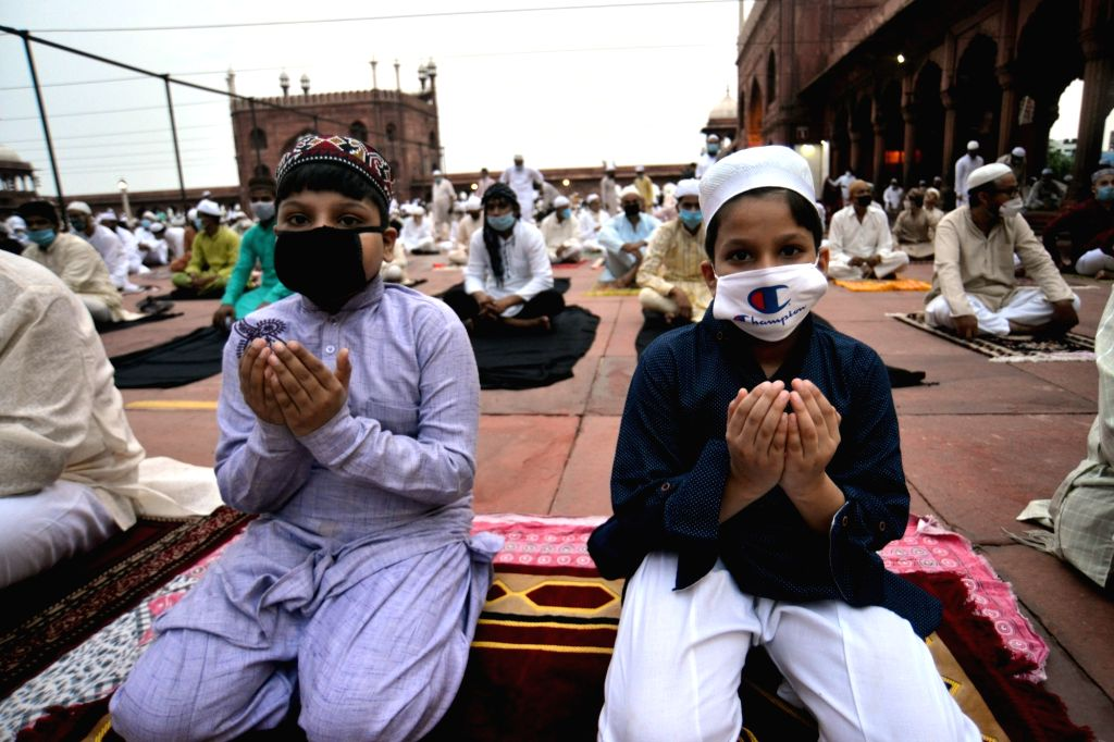 Children pray after offering Eid-ul-Adha prayers at the Jama Masjid in Delhi on Aug 1, 2020.