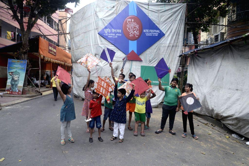 Children prepare to fly kites during a Kite Flying festival on the occasion of Vishakarma Puja in Kolkata on Sep 17, 2017.