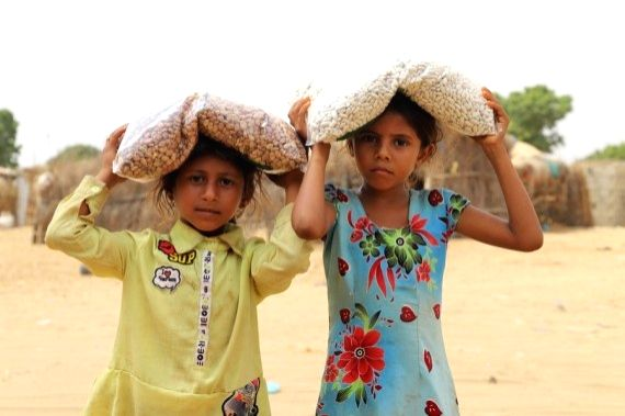 Children receive food from a charity group in Hajjah province, Yemen, March 4, 2021. (Photo by Mohammed Al-Wafi/Xinhua/IANS)