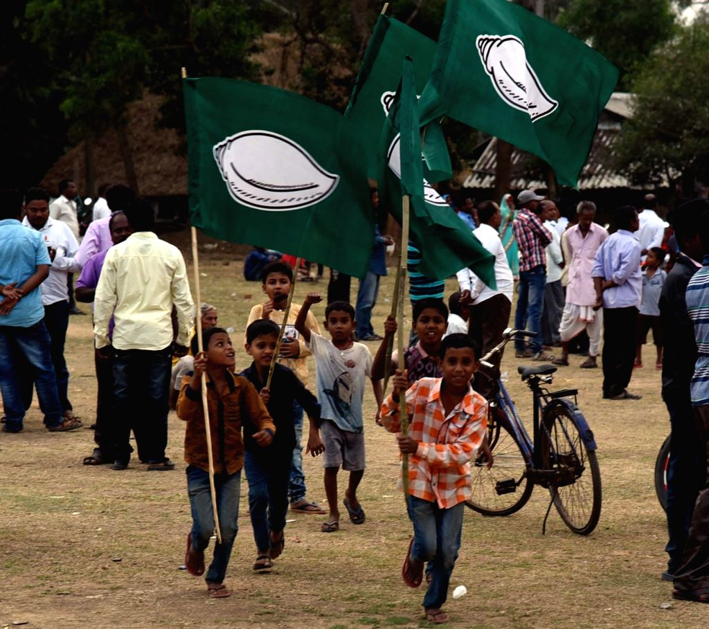 Children run holding Biju Janata Dal (BJD) flags during an election campaign ahead of 2019 Lok Sabha elections, in Bhubaneswar on March 14, 2019.