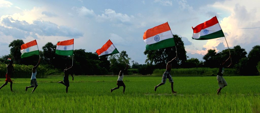Children run holding the Indian flag ahead of Independence Day in a village near Balurghat of West Bengal's South Dinajpur district, on Aug 4, 2016.