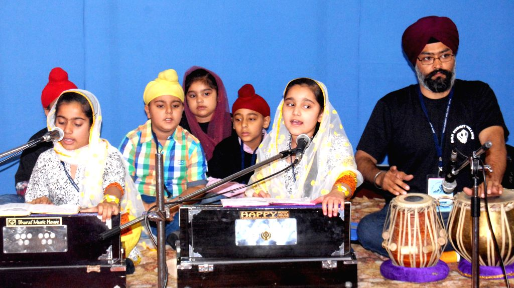 Children taking part in the Gurbani Kirtan Competition organised during the inaugural day of the three day long Sikh Summit at the Singh Sabha Gurduwara in Shillong on April 18, 2014.