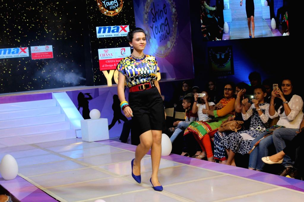 Children walk on ramp during the Shine Young 2016 -A talent platform for kids, in Mumbai, on Nov 13, 2016.