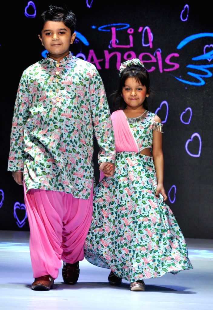 Children walk the ramp  during Junior's Fashion Week in Kolkata on Sept 3, 2017.