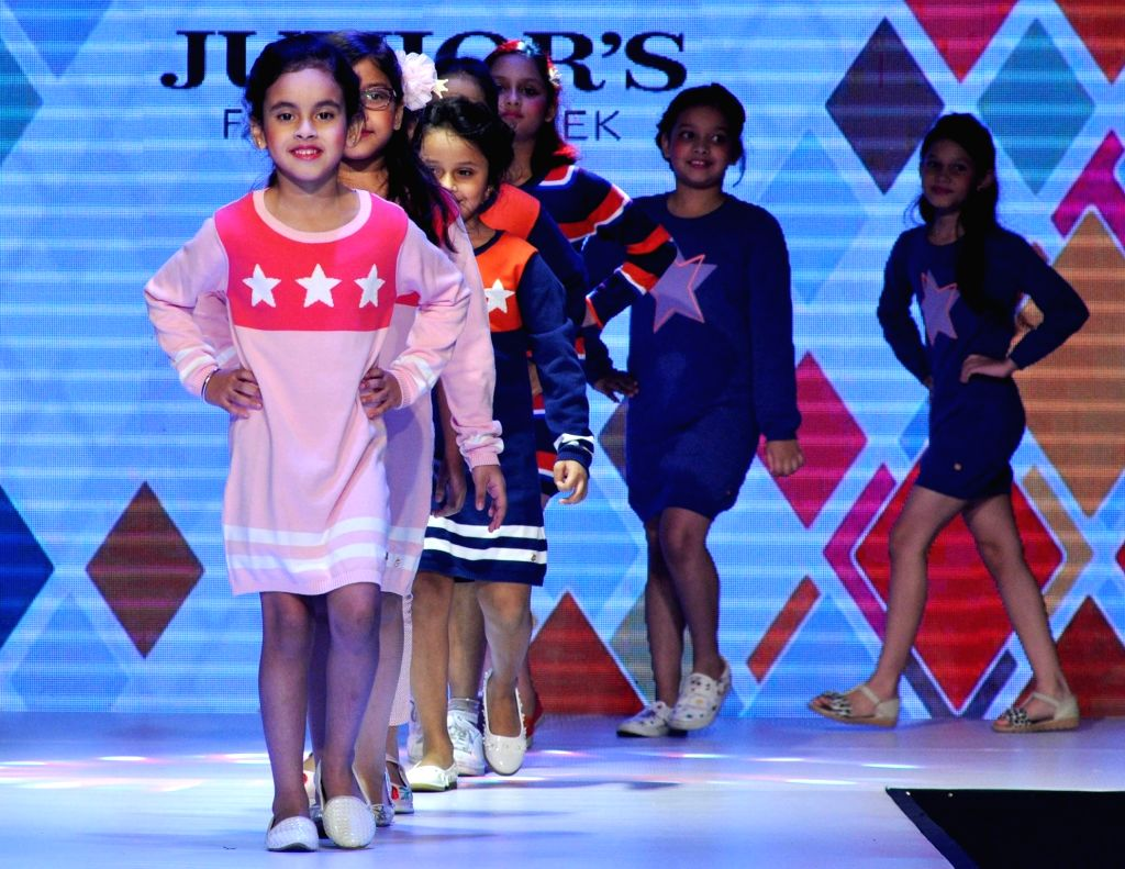 Children walk the ramp  during Junior's Fashion Week in Kolkata on Sept 3, 2017.