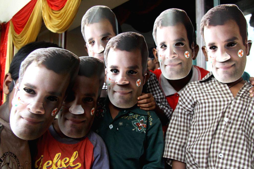 Children wear Rahul Gandhi`s masks during the 55th Youth Congress Foundation Day celebrations, at Patel Bhavan, in Bangalore on Aug. 9, 2014. - Rahul Gandhi