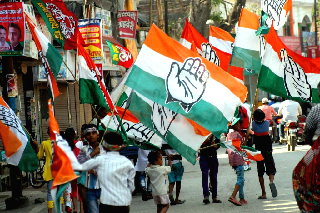 Children with Congress party flags during the roadshow of Congress vice president Rahul Gandhi in Varanasi on May 10, 2014.