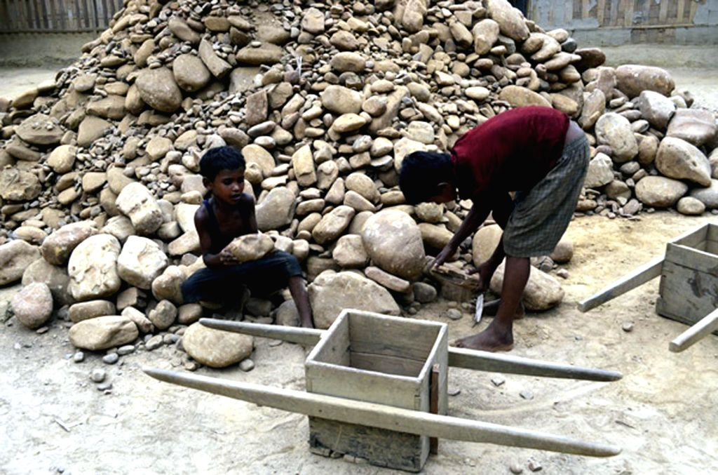 Children work at a stone crushing unit in Churaibari area of Tripura on April 30, 2014, a day ahead of International Workers' Day which is celebrated worldwide on 1st May to commemorate historic ...