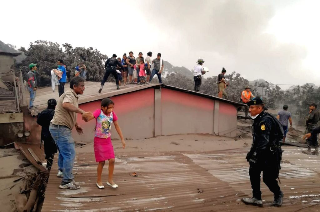 "CHIMALTENANGO, June 4, 2018 - Civil Protection members evacuate residents from a house during the eruption of the ""Volcan de Fuego"", in Acatenango, Chimaltenango Department, Guatemala, on ..."