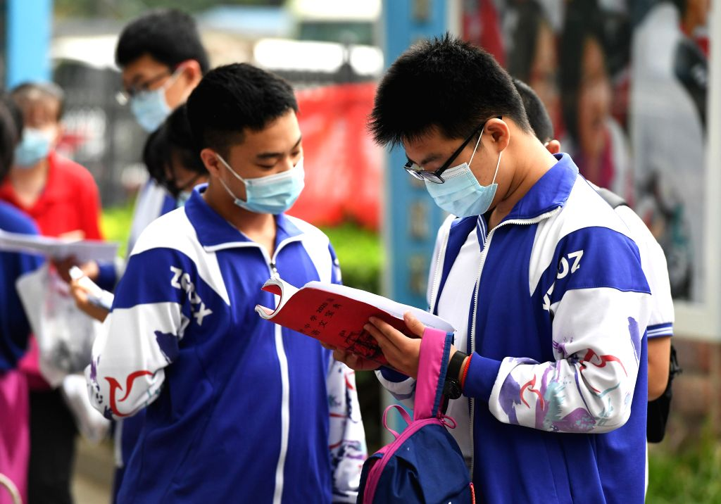 China begins new school year with strict Covid-19 measures