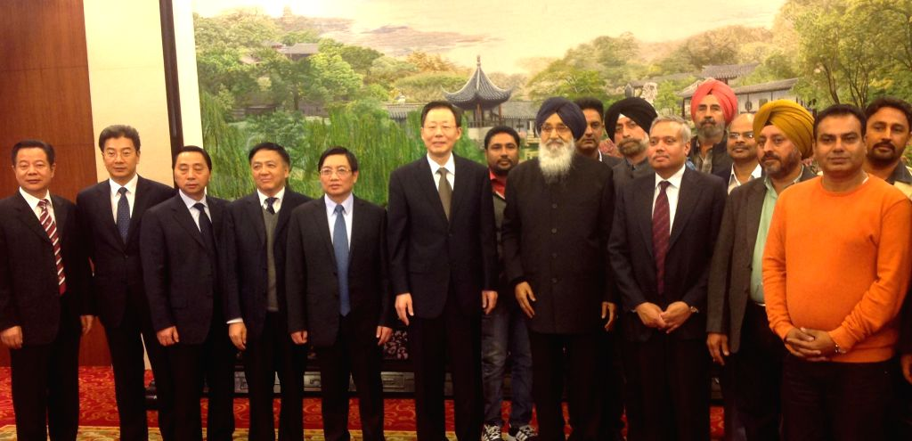 Punjab Chief Minister Parkash Singh Badal with the Governor of the Jiangsu province of China, Li Xueyong during his visit to China. - Parkash Singh Badal