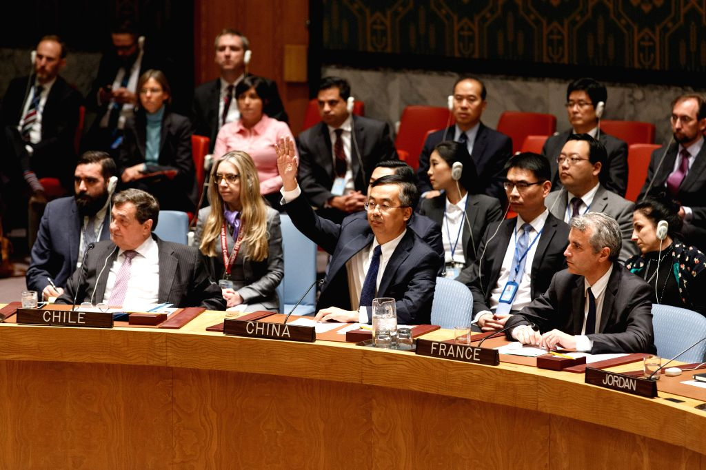 China's deputy permanent representative to the United Nations Wang Min (C) gestures during a meeting of the UN Security Council on the situation in the Democratic ...