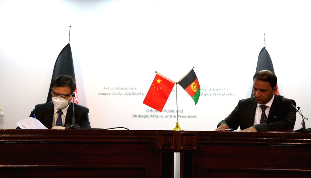 Chinese Ambassador to Afghanistan Wang Yu (L) and Ghulam Bahauddin Jailani, Afghan State Minister for Disaster Management and Humanitarian Affairs, sign the ...