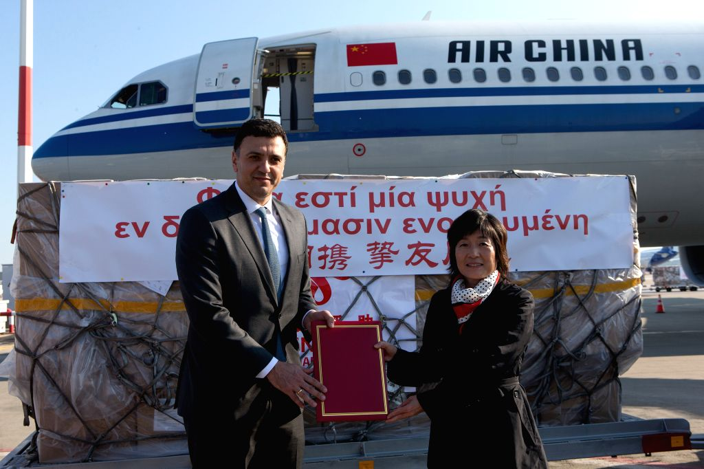 Chinese Ambassador to Greece Zhang Qiyue (R) and Greek Health Minister Vasilis Kikilias attend the handover ceremony of medical supplies in Athens, Greece, on March ... - Vasilis Kikilias
