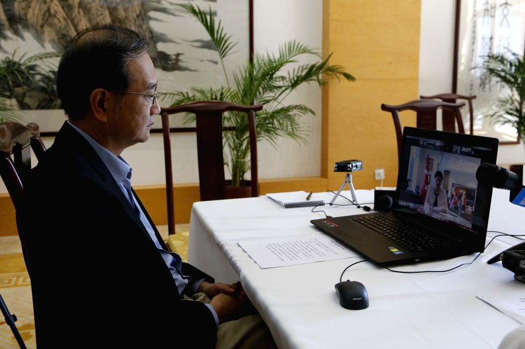 Chinese Ambassador to Turkey Deng Li hosts a video conference of Turkish and Chinese medical experts in Ankara, Turkey, on June 24, 2020. Turkish medical experts on ...