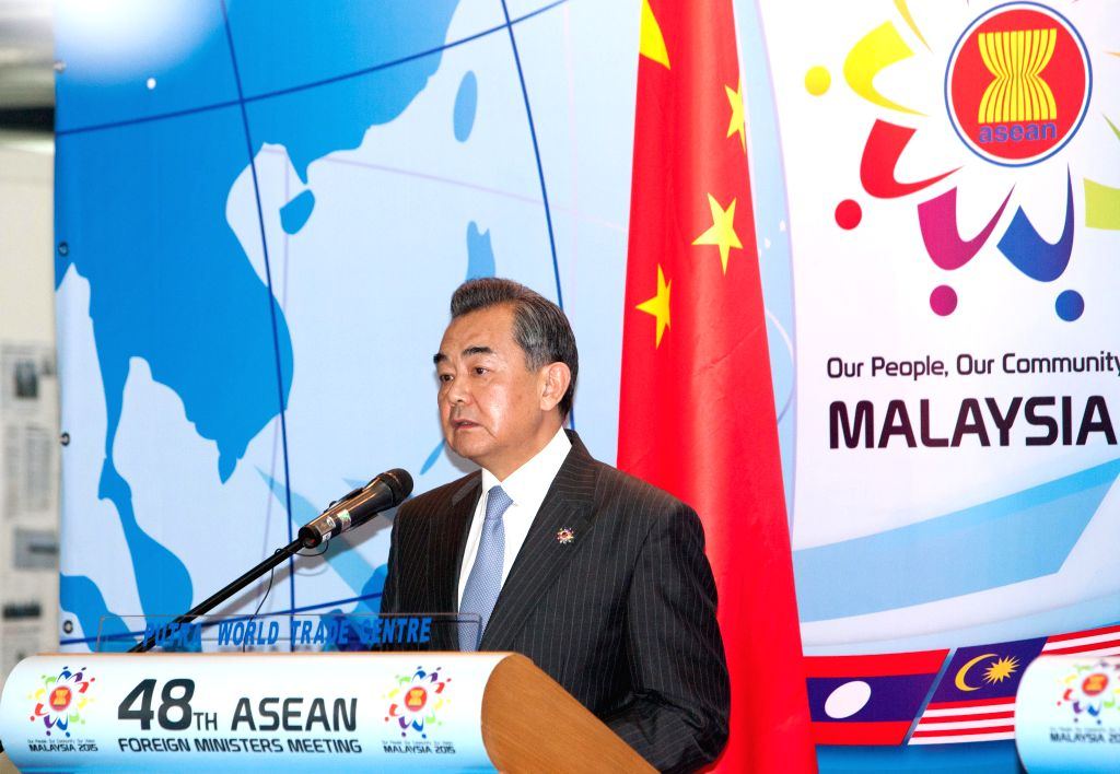 Chinese Foreign Minister Wang Yi attends a press conference during the China-ASEAN Ministerial Meeting in Kuala Lumpur, capital of Malaysia, on Aug. 5, 2015. ... - Wang Y