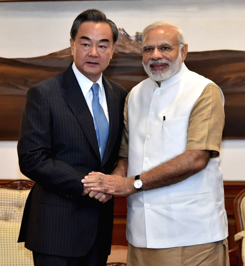 Chinese Foreign Minister Wang Yi calls on Prime Minister Narendra Modi in New Delhi on Aug 13, 2016. - Wang Y and Narendra Modi