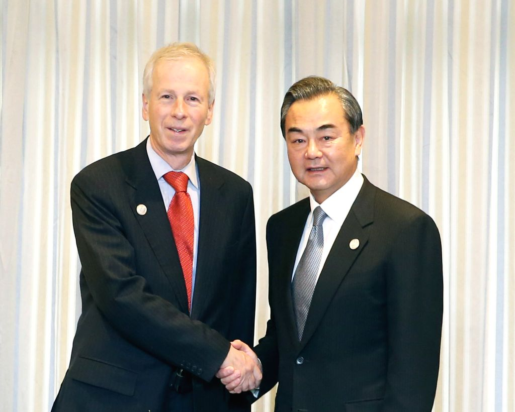 Chinese Foreign Minister Wang Yi (R) shakes hands with Canada's Foreign Affairs Minister Stephane Dion in Manila, the Philippines, Nov. 17, 2015. (Xinhua/Yao ... - Wang Y
