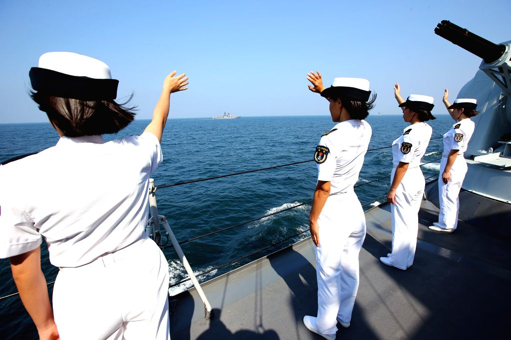 Chinese officers and soldiers waves to say goodbye to Russian fleet during a China-Russia naval joint drill at sea off south China's Guangdong ...